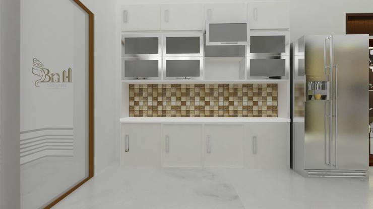 Residential Duplex Villa:  Kitchen by BNH DESIGNERS