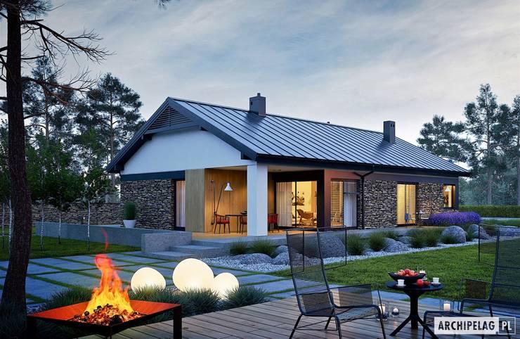 Projekt domu Daniel II G1 z wnętrzem pełnym słońca i ciepła : styl , w kategorii Domy zaprojektowany przez Pracownia Projektowa ARCHIPELAG