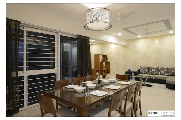 Dining:  Dining room by Akruti Interiors Pune