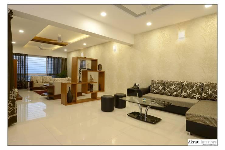 Living:  Living room by Akruti Interiors Pune