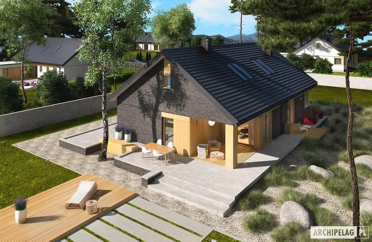 Daniel IV G2 – nowoczesny dom z atrakcyjną antresolą : styl , w kategorii Domy zaprojektowany przez Pracownia Projektowa ARCHIPELAG