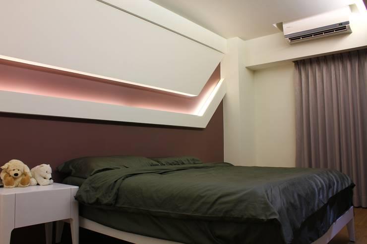 Coigne:  臥室 by 築一國際室內裝修有限公司
