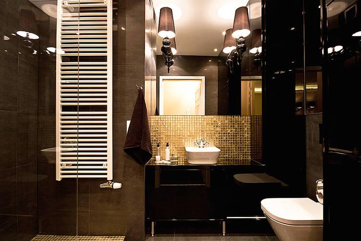 Eklektyczne mieszkanie: styl , w kategorii Łazienka zaprojektowany przez IDAFO projektowanie wnętrz i wykończenie