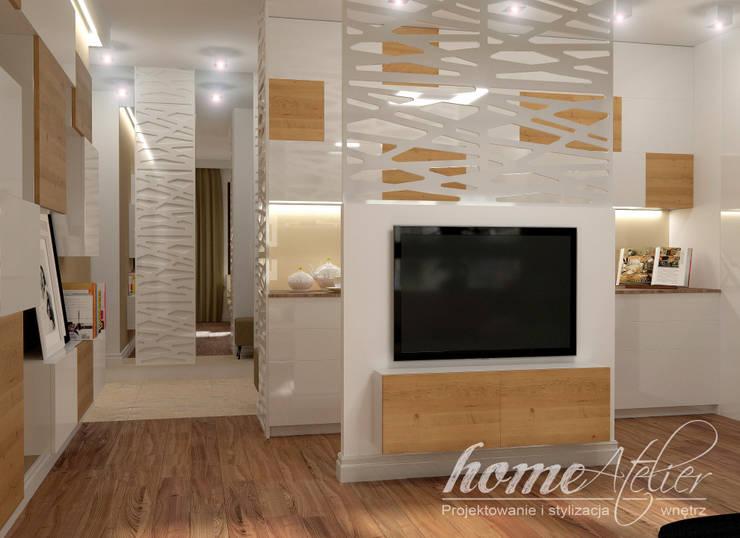 Livings de estilo moderno por Home Atelier