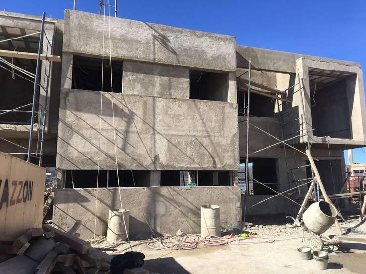 Casa NC: Casas de estilo  por Development Architectural group