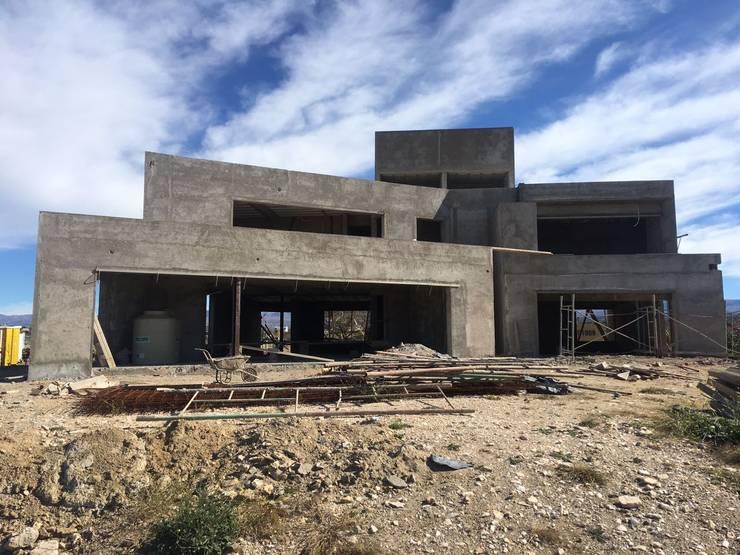 Casa NC: Casas de estilo minimalista por Development Architectural group