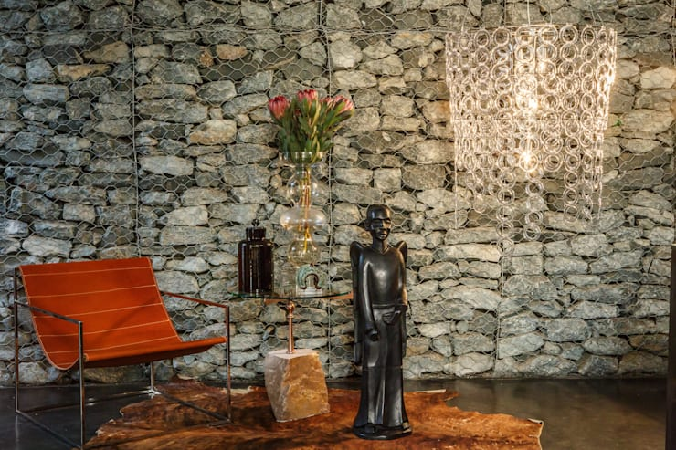 Interior spaces:  Living room by Egg Designs CC, Modern Stone