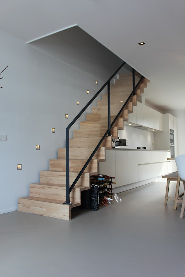 PU-gietvloer als basis voor een warm interieur:  Gang, hal & trappenhuis door Motion Gietvloeren