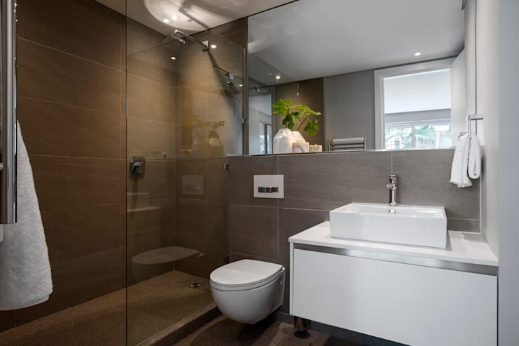 WATERFRON STAY_GULMARN APARTMENTS:  Bathroom by MINC DESIGN STUDIO,