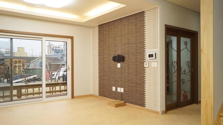 밀양 가곡동 목조주택 30평 : 한다움건설의  거실