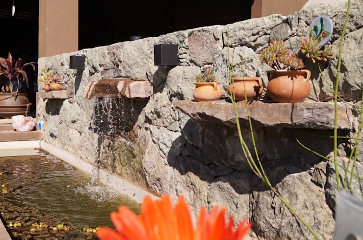 Jardines de estilo rústico por Abitar arquitectura