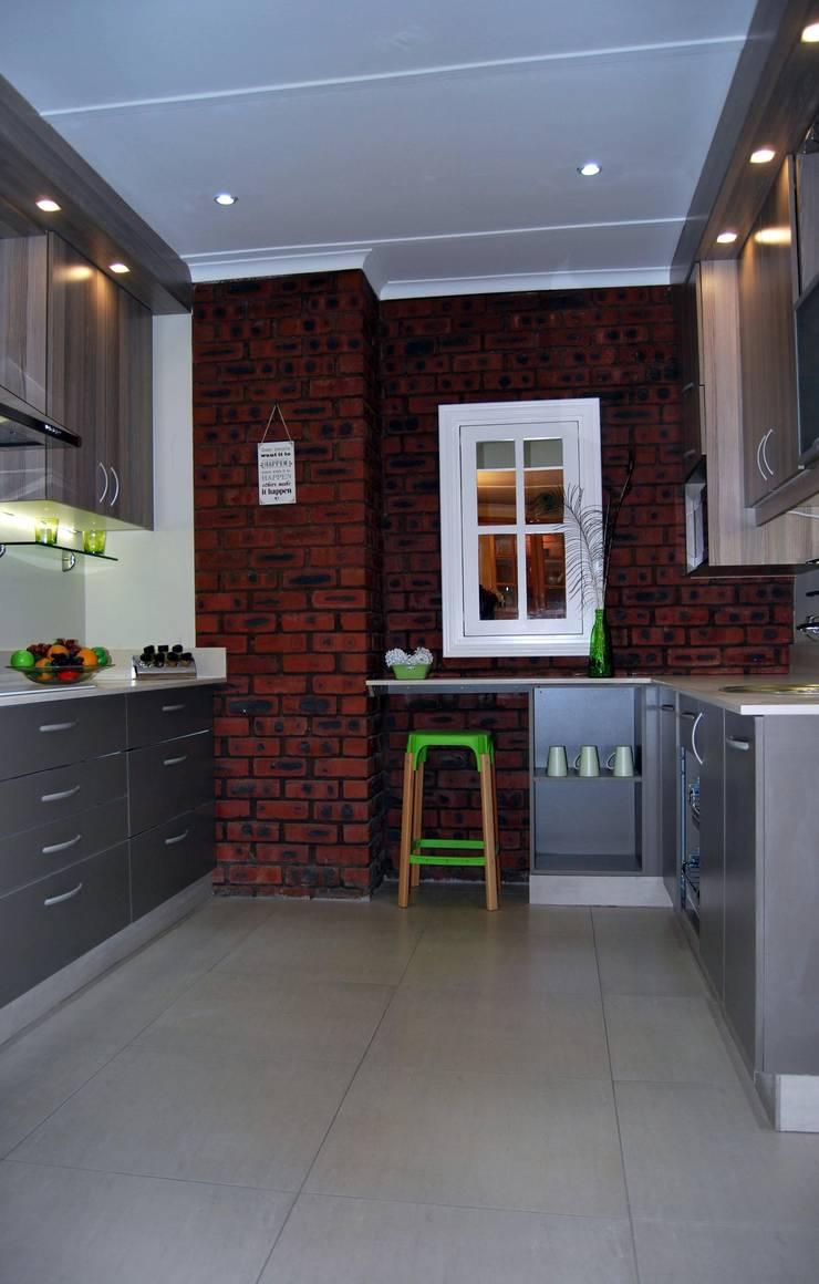 Showroom Revamp:  Kitchen by Capital Kitchens cc, Modern Wood Wood effect