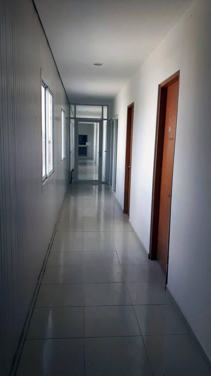 Antes: Estudios y despachos de estilo  por DM arquitectura , Industrial