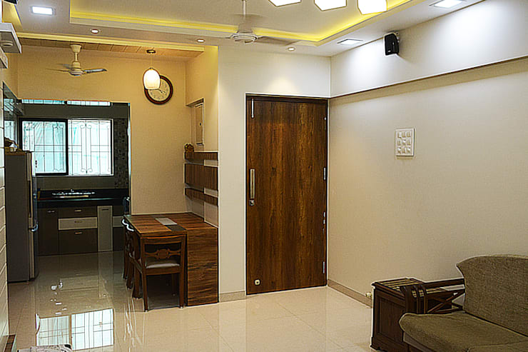 Dining area and hallway entrance:  Dining room by Vinayak Interior | Interior Designing and Decorator Companies