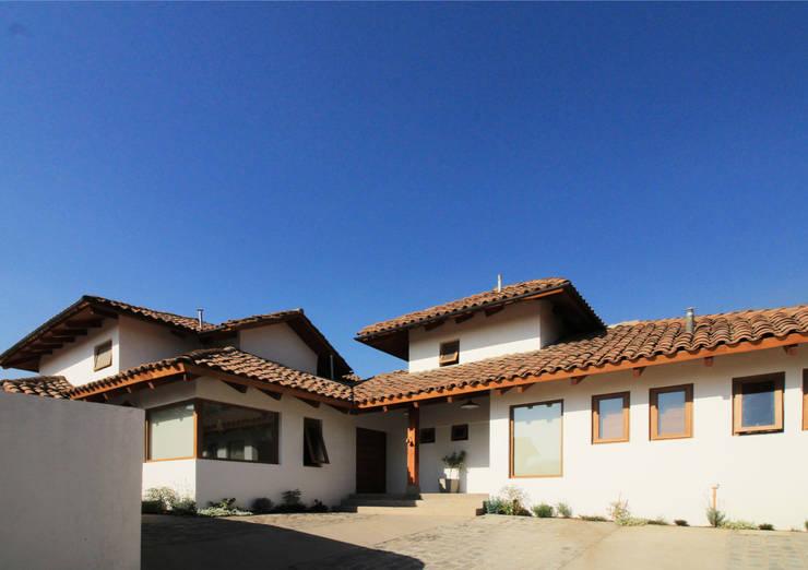 Casa D: Casas de estilo  por Carvallo & Asociados Arquitectos