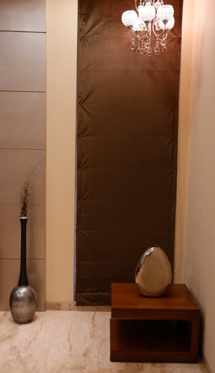 Singh Bunglow—Kalyan:  Living room by Aesthetica