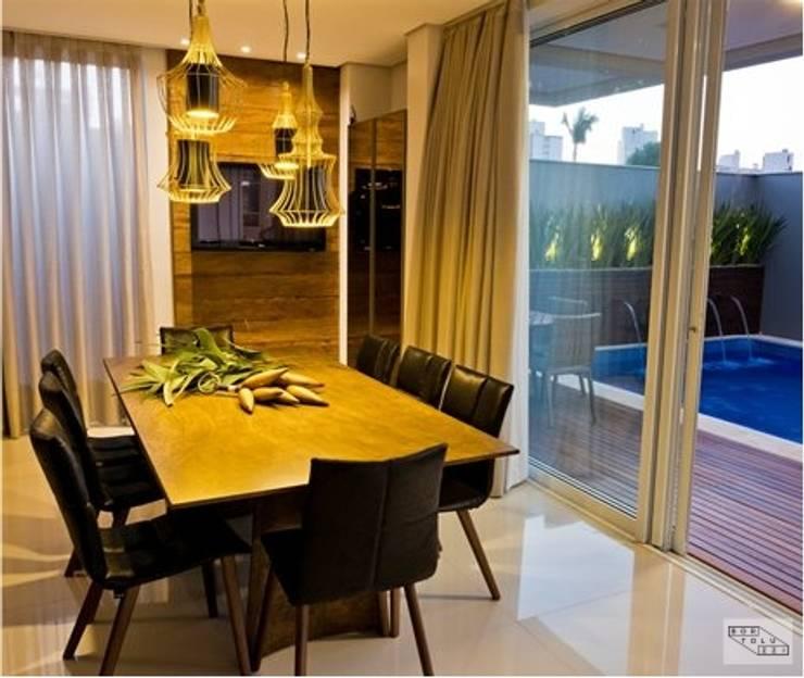 Minimalist dining room by Bortoluzzi Arquitetura Minimalist Ceramic