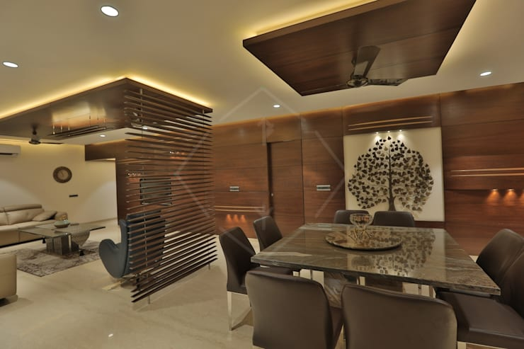 SKY DECK:  Dining room by SPACCE INTERIORS