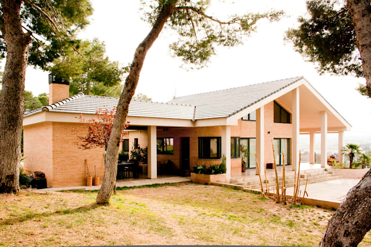 Casas de estilo  por navarro+vicedo arquitectura