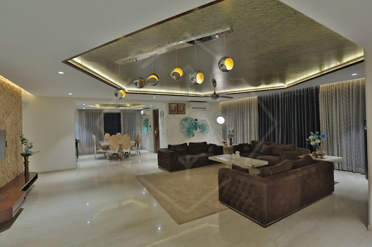 Living room by SPACCE INTERIORS,