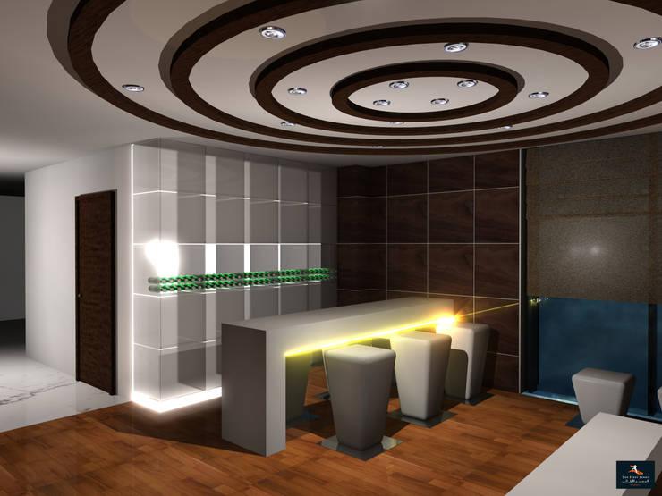 Loft Apartment:  Dining room by Gurooji Designs,Modern