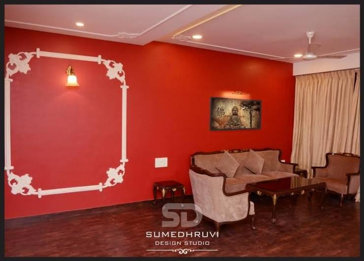 Living room by SUMEDHRUVI DESIGN STUDIO
