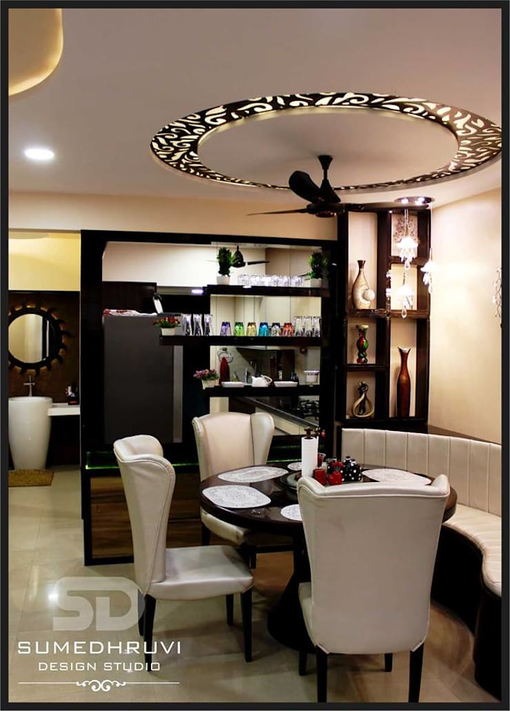 Dining and Passage Area: modern Dining room by SUMEDHRUVI DESIGN STUDIO