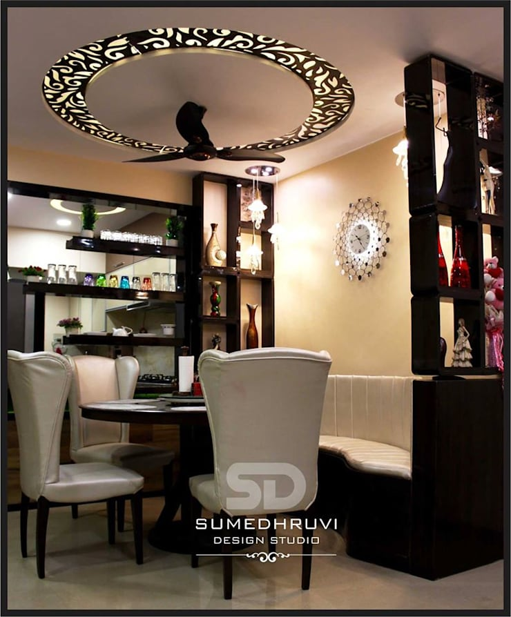Dining Area Specifying Round Table with Chairs and Ledge Seating: modern Dining room by SUMEDHRUVI DESIGN STUDIO