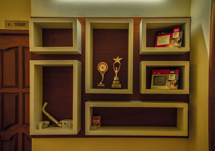Medal Shelf:  Office spaces & stores  by Studio Madras Architects