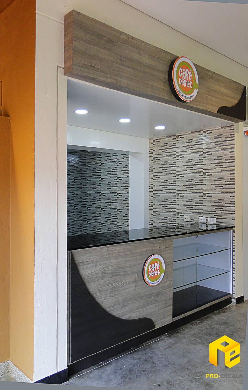 Cafe Planet Universidad Politecnico Gran Colombiano de Pro Escala Arquitectos SAS Moderno