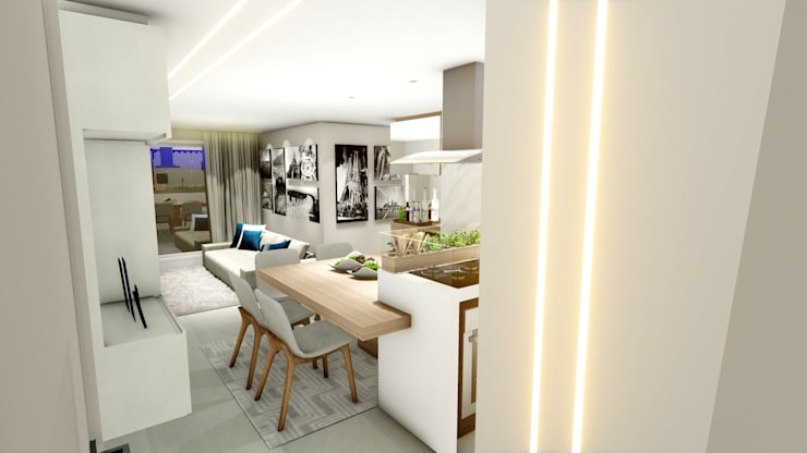 Apartamento compacto para jovem casal moderno: Salas de jantar  por Studio²