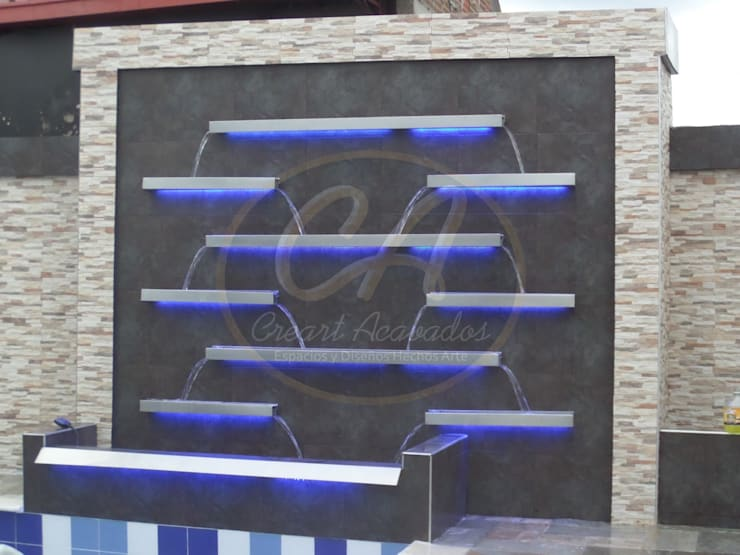 Fuente de agua en escalas, fabricada con acero inox: Piscinas de estilo  por Creart Acabados,