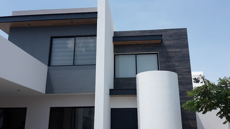 CASA-EM: Casas de estilo  por RIVERA ARQUITECTOS