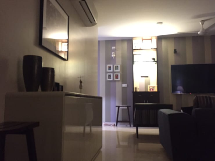Private Reisdence—3bhk apartment:  Living room by One sq. meter Architects & Interior Designers