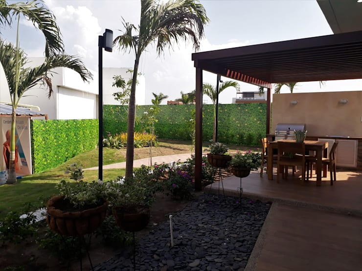 Casa modelo Cerdeña – Novaterra Ocean City: Jardines de estilo  por ecoexteriores