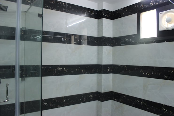 Full house Architecture & Interior Designing:  Bathroom by Prodigy Designs