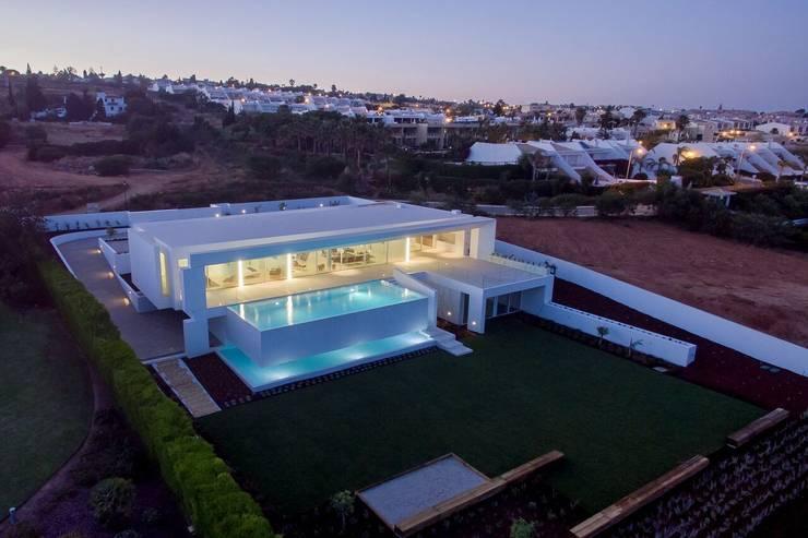Casa Carrara Vista aérea : Casas  por Tendenza -  Interiors & Architecture Studio