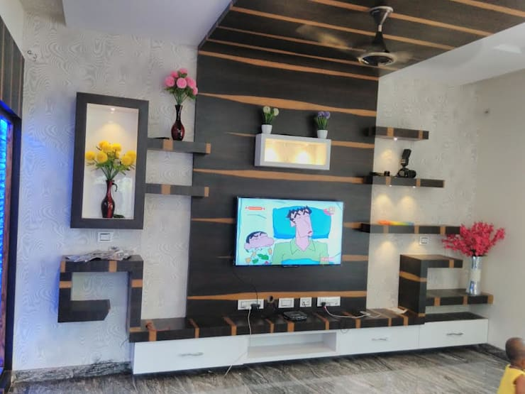 Tv Unit:  Living room by Chavadi Interiors
