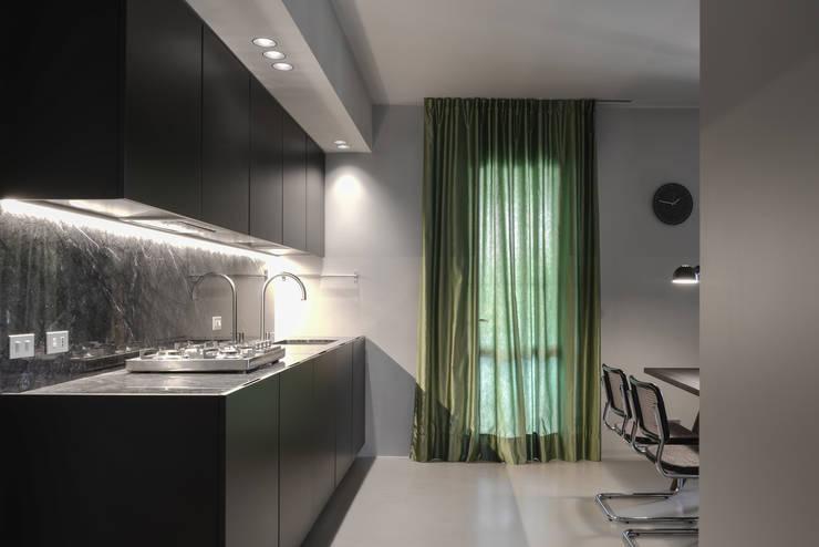 Modern kitchen by MIDE architetti Modern