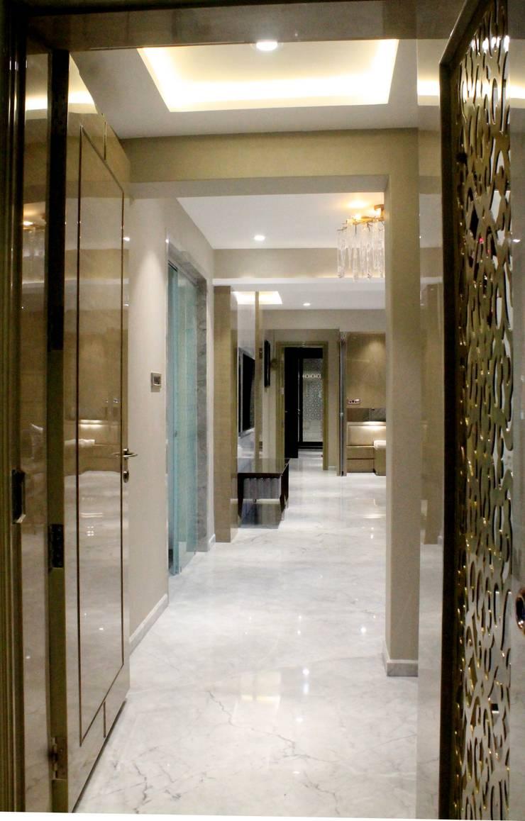 ETHNIC TOUCHE:  Corridor & hallway by MIDAS DESIGN STUDIO,Asian