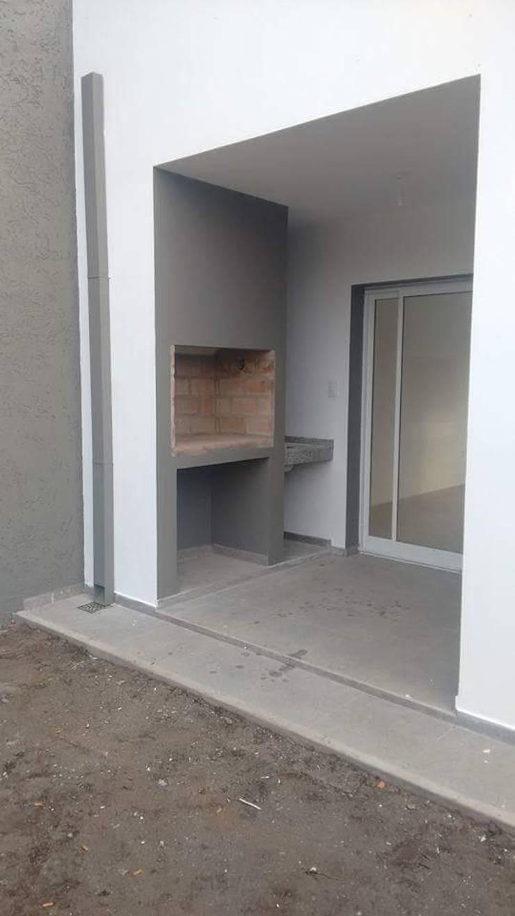 Dúplex NM | Miradores de Manantiales: Casas de estilo  por Arquitecto Nicolás Mora