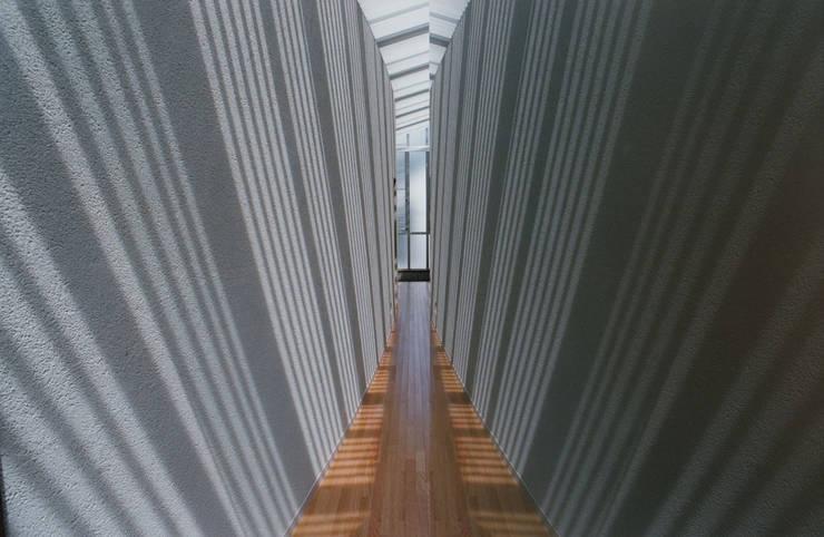 2階廊下: 株式会社ラウムアソシエイツ一級建築士事務所が手掛けた廊下 & 玄関です。