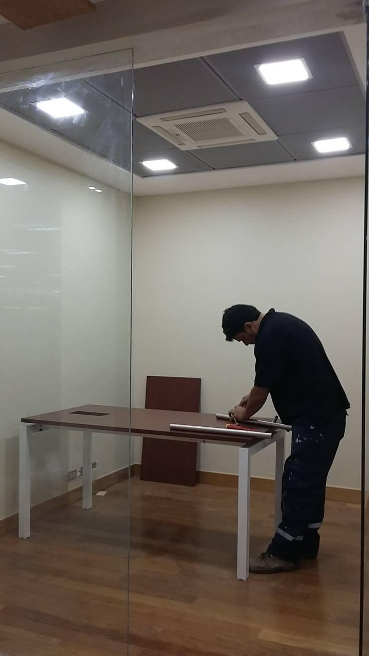 Inspección técnica remodelación Plataforma Banca Preferente Banco Chile, Plaza Prat, Iquique.:  de estilo  por Gerardo Cervellino EIRL