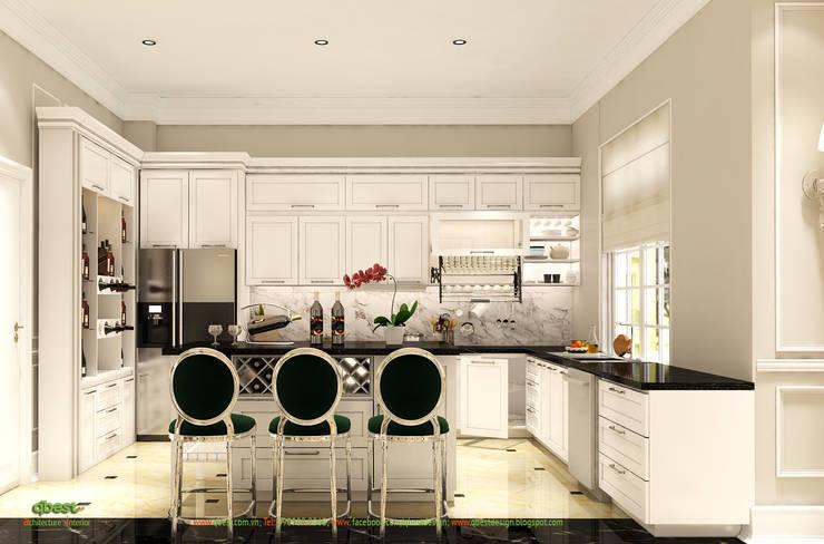 Bếp với bàn đảo:  Kitchen by Công ty TNHH Thiết Kế và Ứng Dụng QBEST