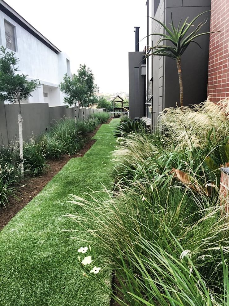 Lush and soft even in summer:  Garden by Acton Gardens
