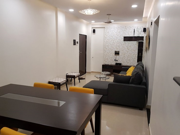 andheri west 2 bhk: modern Living room by The Red Brick Wall