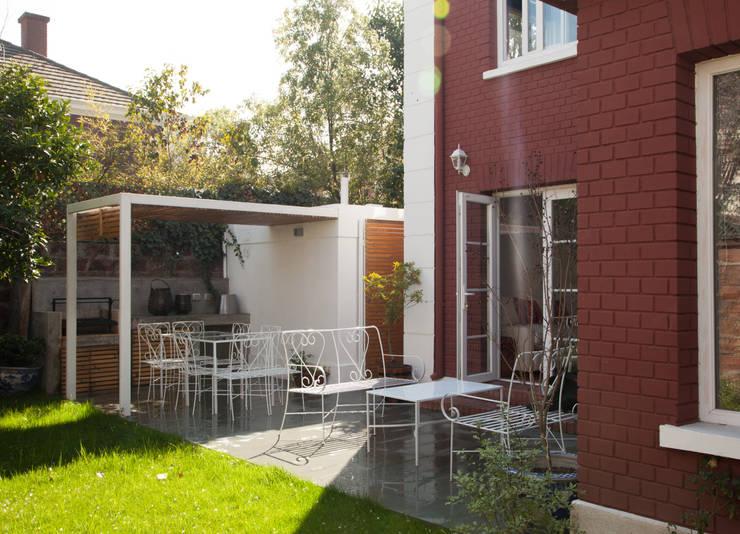 Quincho : Jardines de estilo  por RENOarq