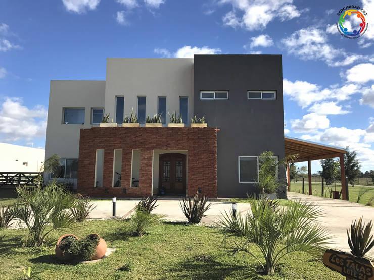 Construcción al Costo en Puertos - Lago Escobar: Casas de estilo  por Comunidad CO3