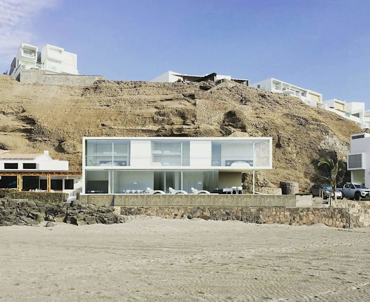 Casa en playa Misterio Casas de estilo minimalista de ARCHITECTS Minimalista Concreto