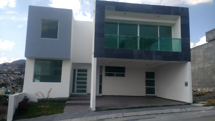 FACHADA: Casas de estilo moderno por + Ingenio Arquitectura y Diseño